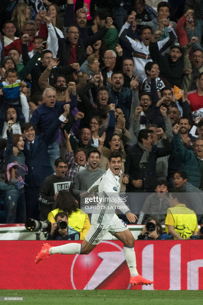 Real Madrid's forward Alvaro Morata celebrates after scoring during the UEFA Champions League football match Real Madrid CF vs Sporting CP at the Santiago Bernabeu stadium in Madrid on September 14, 2016. / AFP / CURTO