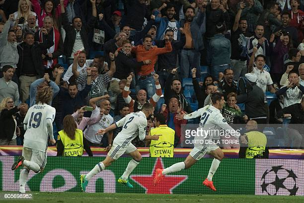 Real Madrid's forward Alvaro Morata celebrates after scoring during the UEFA Champions League football match Real Madrid CF vs Sporting CP at the...