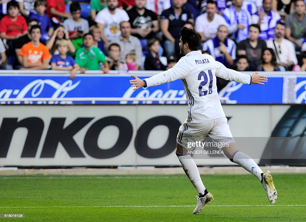 Real Madrid's forward Alvaro Morata celebrates after scoring his team's third goal during the Spanish league football match between Deportivo Alaves and Real Madrid CF at the Mendizorroza stadium in Vitoria on October 29, 2016. / AFP / ANDER