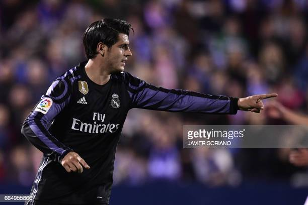 Real Madrid's forward Alvaro Morata celebrates after scoring their third goal during the Spanish league football match Club Deportivo Leganes SAD vs...