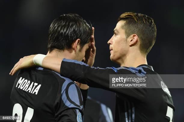 Real Madrid's forward Alvaro Morata celebrates with Real Madrid's Portuguese forward Cristiano Ronaldo after scoring at the end of the UEFA Champions...