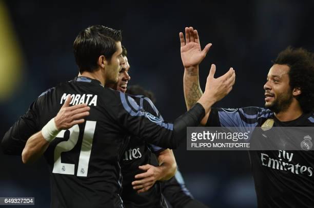 Real Madrid's forward Alvaro Morata celebrates with teammates Real Madrid's Brazilian defender Marcelo and Real Madrid's Portuguese defender Pepe...