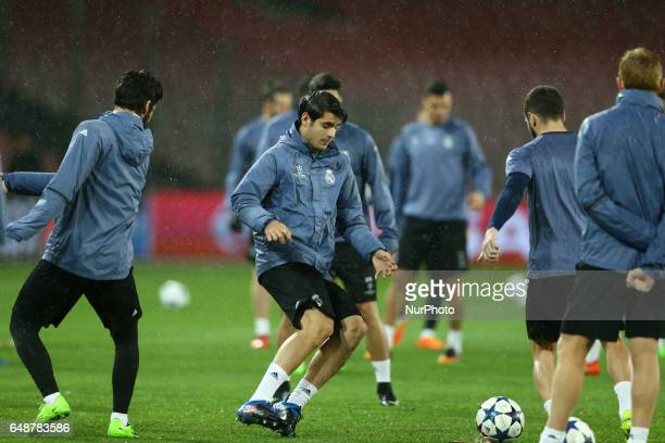 Real Madrid's forward Alvaro Morata during a training session under heavy rain on the eve of the Champions League football match Napoli vs Real...