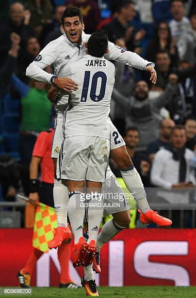 Real Madrid's forward Alvaro Morata is congratulated by Real Madrid's Colombian midfielder James Rodriguez after scoring during the UEFA Champions...