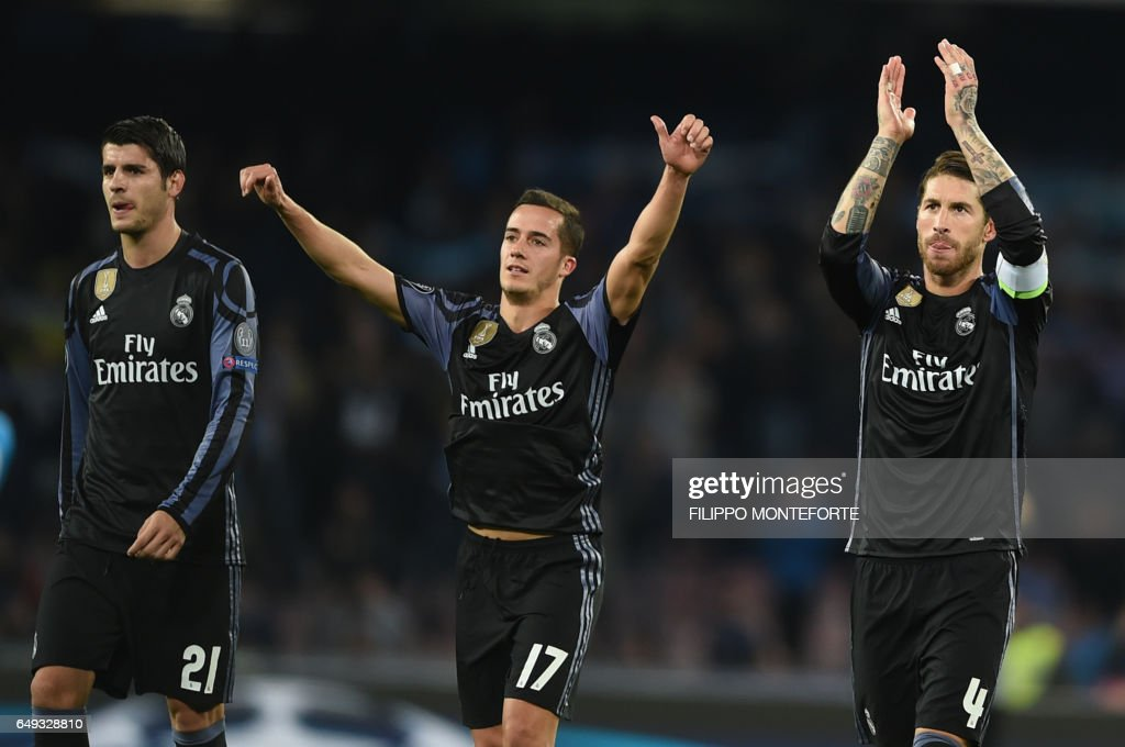 Real Madrid's forward Alvaro Morata (L), Real Madrid's midfielder Lucas Vazquez (C) and Real Madrid's defender Sergio Ramos celebrate at the end of the UEFA Champions League football match SSC Napoli vs Real Madrid on March 7, 2017 at the San Paolo stadium in Naples. Real Madrid won 1-3. / AFP PHOTO / Filippo MONTEFORTE
