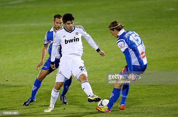 Real Madrid's forward Alvaro Morata vies with Alcoyano's midfielder Javier Lara Grande during the Copa del Rey firstleg football match CD Alcoyano vs...