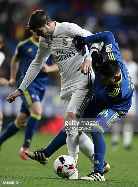 Real Madrid's forward Alvaro Morata vies with Celta Vigo's Argentinian defender Facundo Roncaglia during the Spanish Copa del Rey quarterfinal first...