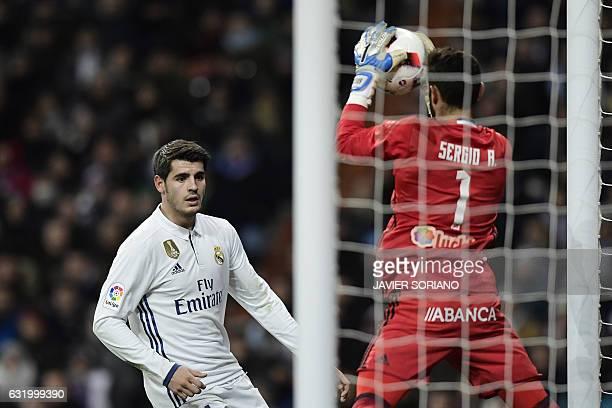 Real Madrid's forward Alvaro Morata vies with Celta Vigo's goalkeeper Sergio Alvarez during the Spanish Copa del Rey quarterfinal first leg football...