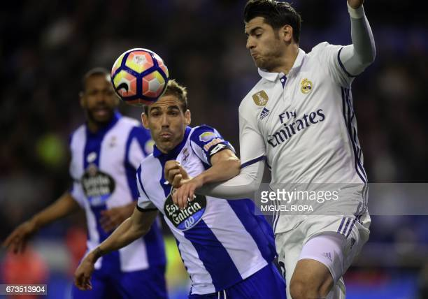 Real Madrid's forward Alvaro Morata vies with Deportivo La Coruna's defender Fernando Navarro during the Spanish league football match RC Deportivo...