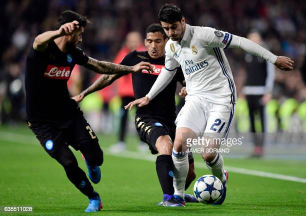 Real Madrid's forward Alvaro Morata vies with Napoli's midfielder from Brazil Allan during the UEFA Champions League round of 16 first leg football...