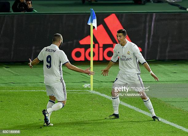 Real Madrid's forward Cristiano Ronaldo celebrates his second goal with forward Karim Benzema against Kashima Antlers during the Club World Cup...