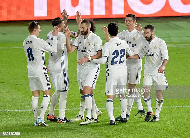 Real Madrid's forward Cristiano Ronaldo celebrates with his teammates after his third goal against Kashima Antlers during the Club World Cup football...