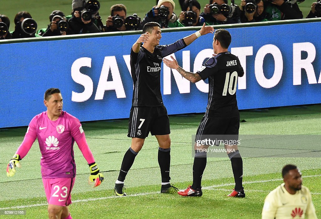 Real Madrid's forward Cristiano Ronaldo (2nd L) is congratulated by teammate James Rodriguez (#10) after scoring a goal during the Club World Cup semi-final football match between Mexico's Club America and Spain's Real Madrid at Yokohama International stadium in Yokohama on December 15, 2016. / AFP / TORU