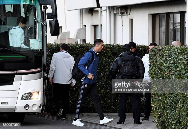Real Madrid's forward Cristiano Ronaldo leaves the bus on the way to a training session at Mitsuzawa stadium in Yokohama on December 16 ahead of...