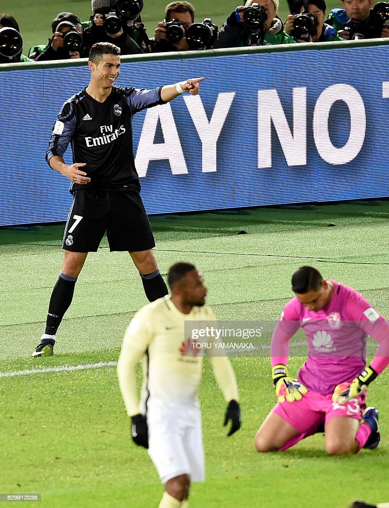 Real Madrid's forward Cristiano Ronaldo (L) reacts after scoring a goal during the Club World Cup semi-final football match between Mexico's Club America and Spain's Real Madrid at Yokohama International stadium in Yokohama on December 15, 2016. / AFP / TORU