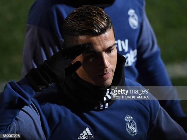 Real Madrid's forward Cristiano Ronaldo salutes during a training session at Mitsuzawa stadium in Yokohama on December 16 ahead of their Club World...