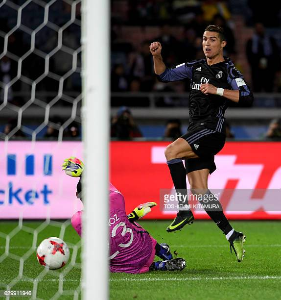 Real Madrid's forward Cristiano Ronaldo scores a goal past Club America's goalkeeper Moises Munoz during the Club World Cup semifinal football match...