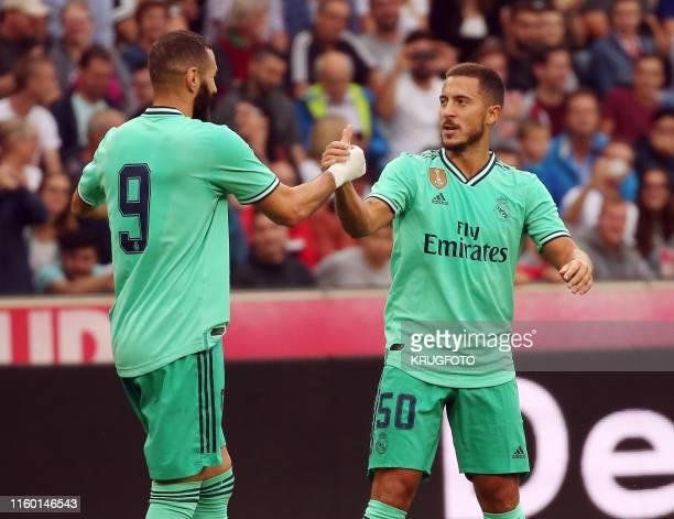 Real Madrid's forward Eden Hazard celebrates scoring with his teammate Real Madrid's French forward Karim Benzema during the preSeason friendly...