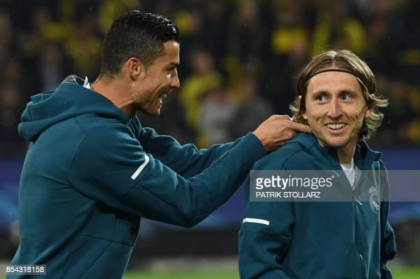 Real Madrid's forward from Portugal Cristiano Ronaldo and Real Madrid's midfielder from Croatia Luka Modric joke around prior to the UEFA Champions...