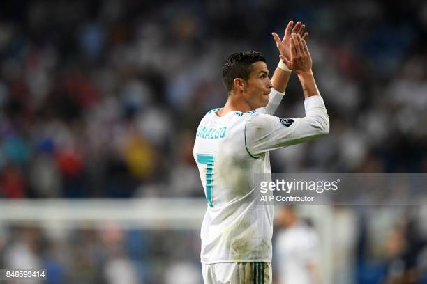 Real Madrid's forward from Portugal Cristiano Ronaldo applauds after the UEFA Champions League football match Real Madrid CF vs APOEL FC at the...