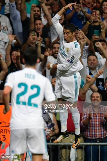 Real Madrid's forward from Portugal Cristiano Ronaldo celebrates after scoring during the UEFA Champions League football match Real Madrid CF vs...