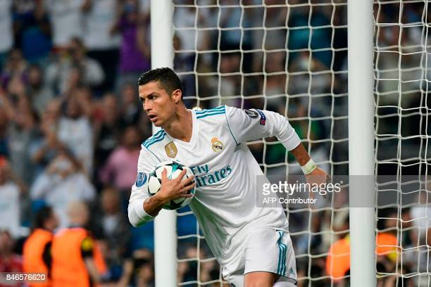 Real Madrid's forward from Portugal Cristiano Ronaldo celebrates after scoring on a penalty kick during the UEFA Champions League football match Real...