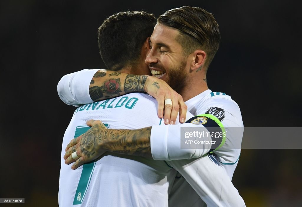 Real Madrid's forward from Portugal Cristiano Ronaldo (L) celebrates scoring with Real Madrid's defender from Spain Sergio Ramos during the UEFA Champions League Group H football match BVB Borussia Dortmund v Real Madrid in Dortmund, western Germany on September 26, 2017. / AFP PHOTO / Patrik STOLLARZ