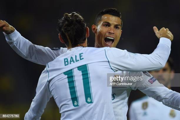 Real Madrid's forward from Portugal Cristiano Ronaldo celebrates scoring with his teammate forward from Wales Gareth Bale during the UEFA Champions...