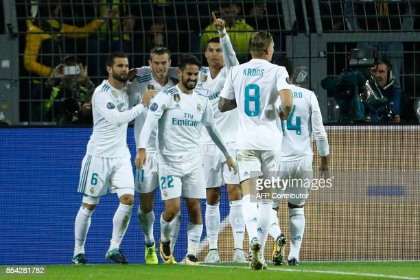 Real Madrid's forward from Portugal Cristiano Ronaldo celebrates scoring with his teammates during the UEFA Champions League Group H football match...
