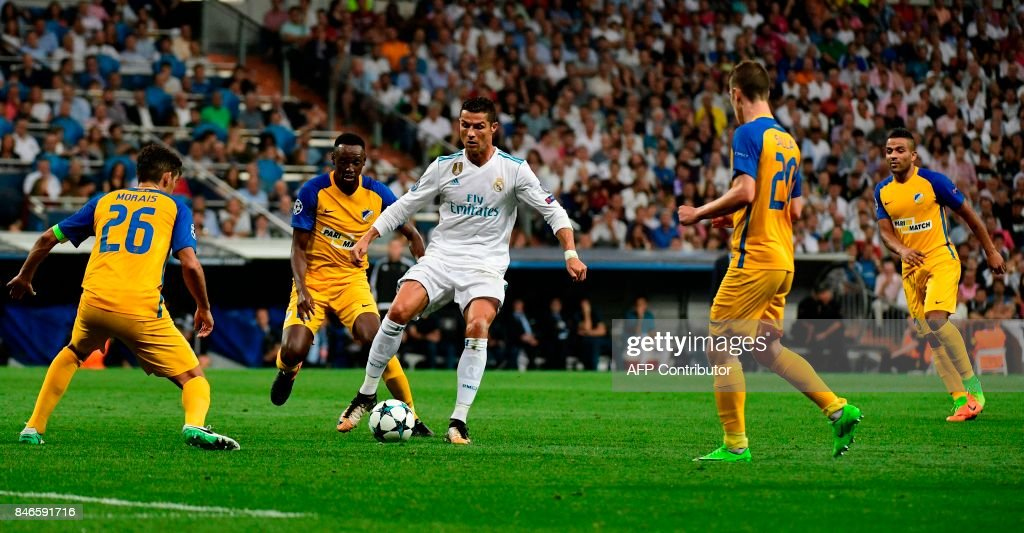 TOPSHOT - Real Madrid's forward from Portugal Cristiano Ronaldo controls the ball during the UEFA Champions League football match Real Madrid CF vs APOEL FC at the Santiago Bernabeu stadium in Madrid on September 13, 2017. /
