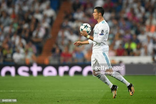 Real Madrid's forward from Portugal Cristiano Ronaldo controls the ball during the UEFA Champions League football match Real Madrid CF vs APOEL FC at...