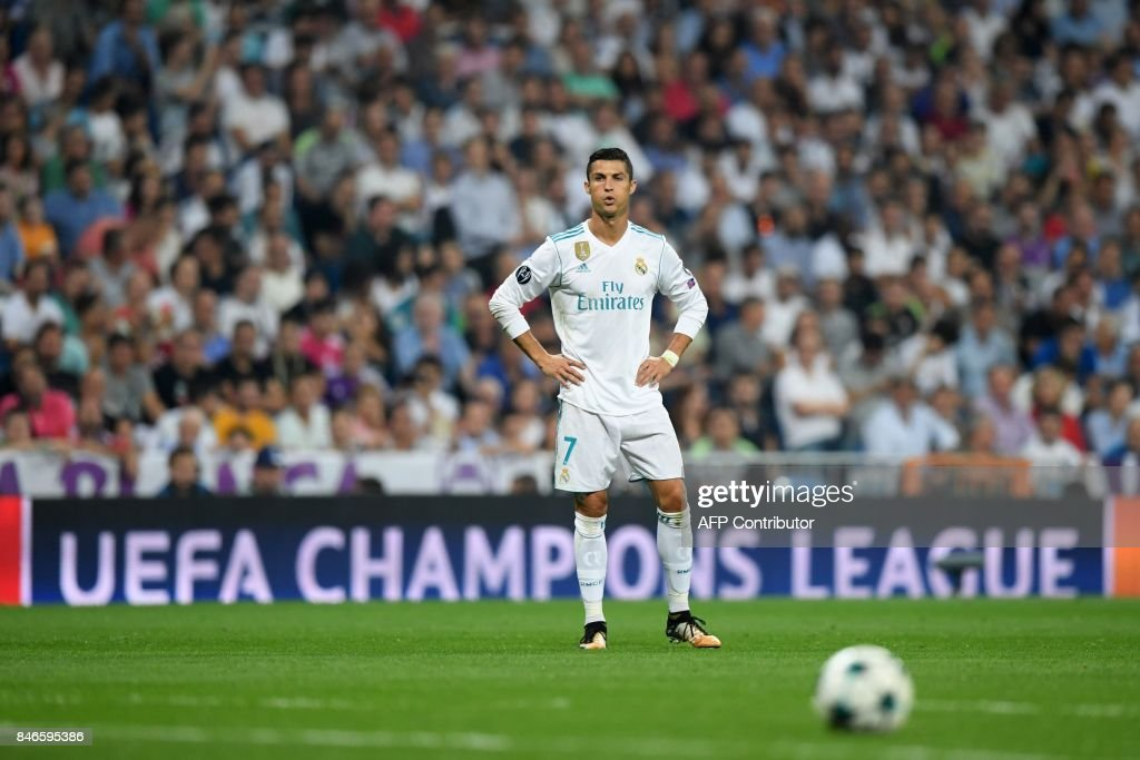 Real Madrid's forward from Portugal Cristiano Ronaldo eyes the ball during the UEFA Champions League football match Real Madrid CF vs APOEL FC at the Santiago Bernabeu stadium in Madrid on September 13, 2017. /