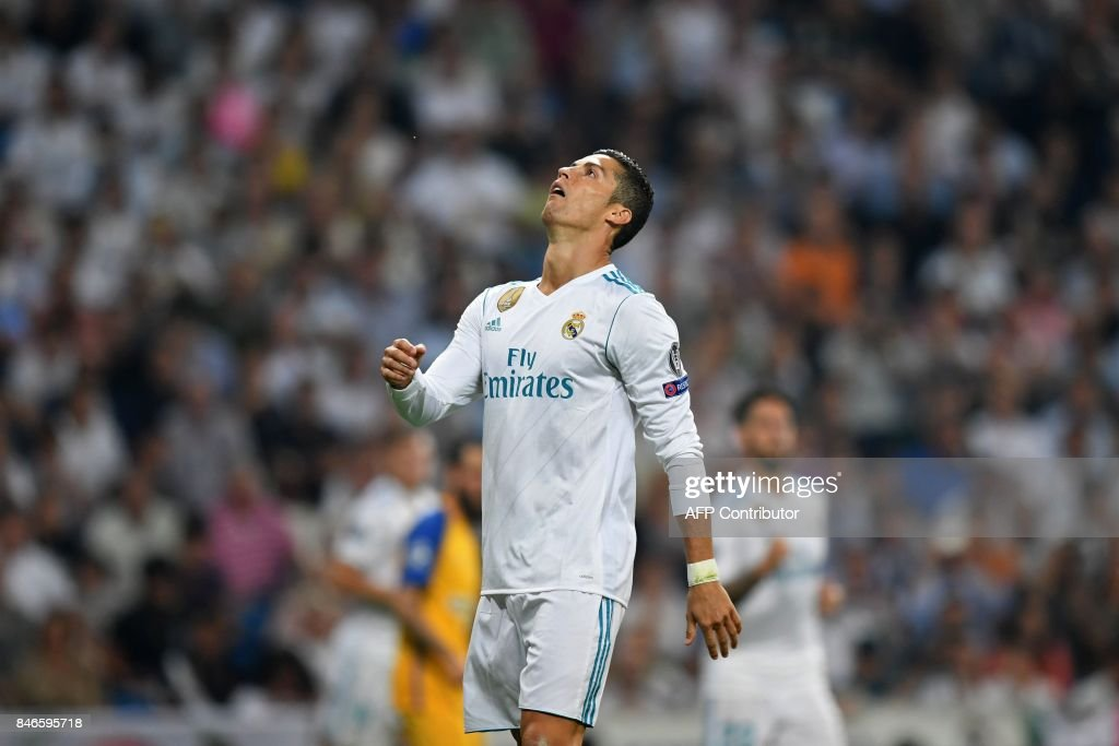 Real Madrid's forward from Portugal Cristiano Ronaldo gestures during the UEFA Champions League football match Real Madrid CF vs APOEL FC at the Santiago Bernabeu stadium in Madrid on September 13, 2017. /