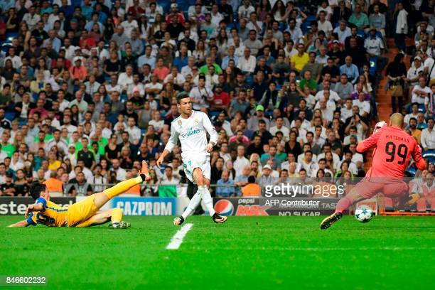 TOPSHOT Real Madrid's forward from Portugal Cristiano Ronaldo kicks the ball past APOEL Nicosia's goalkeeper from the Netherlands Boy Waterman during...