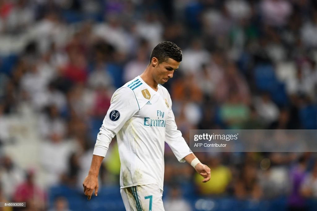 Real Madrid's forward from Portugal Cristiano Ronaldo leaves the pitch after the UEFA Champions League football match Real Madrid CF vs APOEL FC at the Santiago Bernabeu stadium in Madrid on September 13, 2017. /