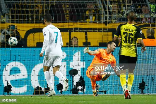 Real Madrid's forward from Portugal Cristiano Ronaldo scores during the UEFA Champions League Group H football match BVB Borussia Dortmund v Real...