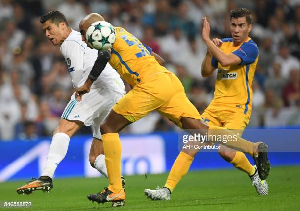 Real Madrid's forward from Portugal Cristiano Ronaldo vies with APOEL's defender from Brazil Carlao during the UEFA Champions League football match...