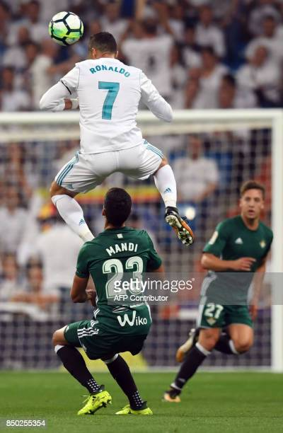 Real Madrid's forward from Portugal Cristiano Ronaldo vies with Real Betis' defender from Algeria Aissa Mandi during the Spanish league football...