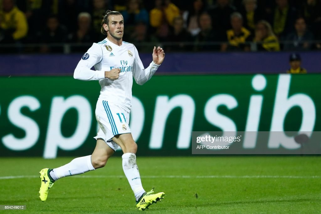 Real Madrid's forward from Wales Gareth Bale celebrates scoring the opening goal during the UEFA Champions League Group H football match BVB Borussia Dortmund v Real Madrid in Dortmund, western Germany on September 26, 2017. / AFP PHOTO / Odd ANDERSEN