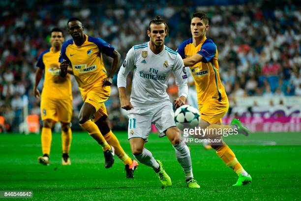 Real Madrid's forward from Wales Gareth Bale eyes the ball during the UEFA Champions League football match Real Madrid CF vs APOEL FC at the Santiago...