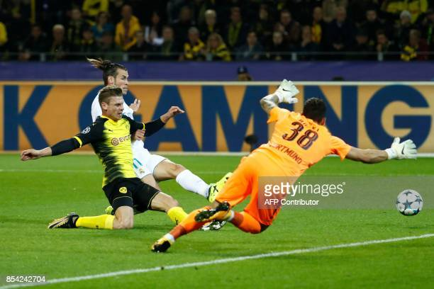 Real Madrid's forward from Wales Gareth Bale fails to get the ball past Dortmund's Swiss goalkeeper Roman Buerki during the UEFA Champions League...
