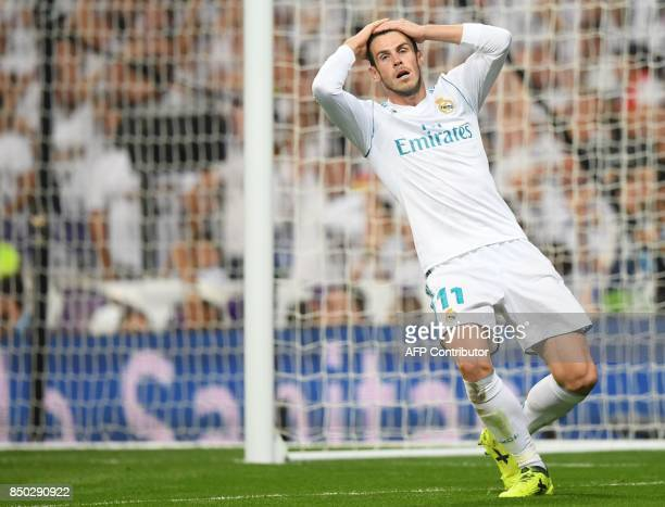 Real Madrid's forward from Wales Gareth Bale gestures after missing an opportunity on goal during the Spanish league football match Real Madrid CF...