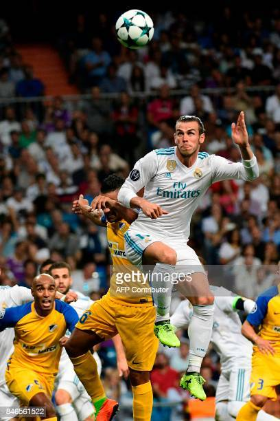 Real Madrid's forward from Wales Gareth Bale heads the ball during the UEFA Champions League football match Real Madrid CF vs APOEL FC at the...