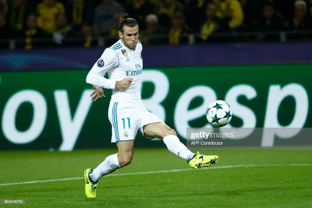 Real Madrid's forward from Wales Gareth Bale scores the opening goal during the UEFA Champions League Group H football match BVB Borussia Dortmund v Real Madrid in Dortmund, western Germany on September 26, 2017. / AFP PHOTO / Odd ANDERSEN