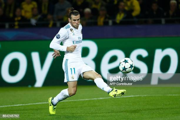 Real Madrid's forward from Wales Gareth Bale scores the opening goal during the UEFA Champions League Group H football match BVB Borussia Dortmund v...