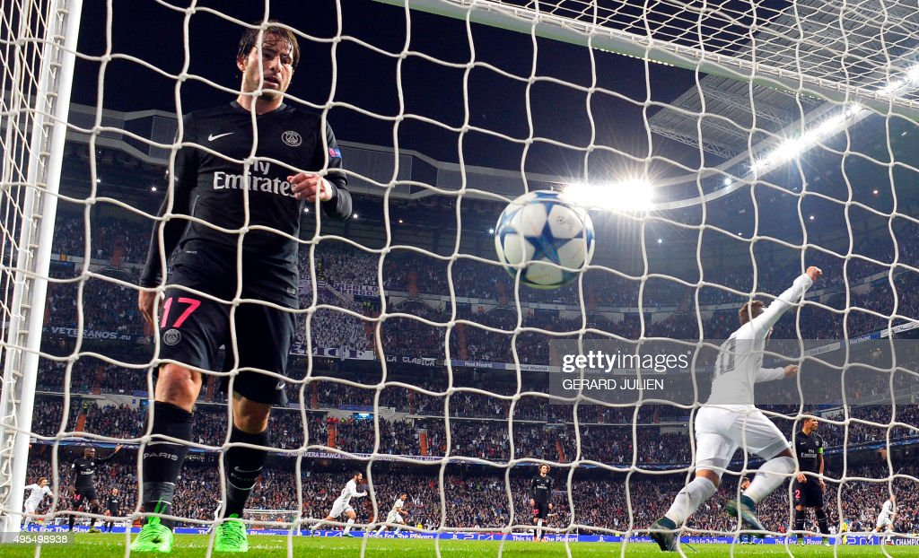 Real Madrid's forward Jese Rodriguez (C) celebrates the goal of Real Madrid's defender Nacho Fernandez (unseen) next to Paris Saint-Germain's Brazilian defender Maxwell (L) during the UEFA Champions League group stage football match Real Madrid CF vs Paris Saint-Germain (PSG) at the Santiago Bernabeu stadium in Madrid on November 3, 2015. AFP PHOTO / GERARD JULIEN