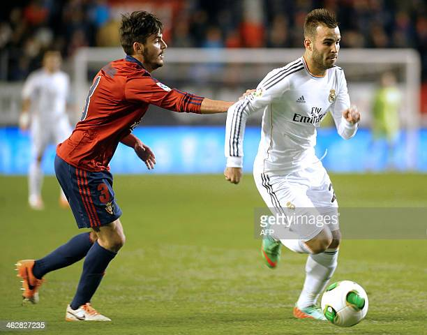 Real Madrid's forward Jese Rodriguez Ruiz vies with Osasuna's defender Joan Oriol during the Spanish Copa del Rey round of 16 secondleg football...