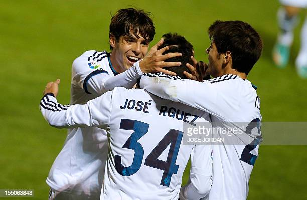 Real Madrid's forward Jose Rodriguez celebrates with his teammates Brazilian midfielder Kaka and forward Alvaro Morata after scoring during the Copa...