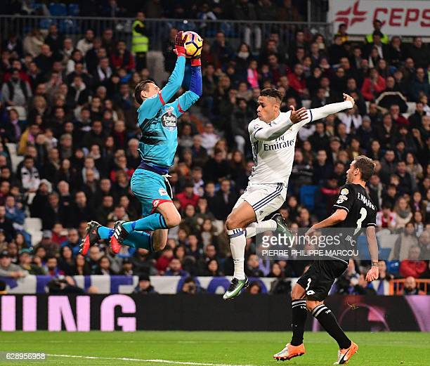 Real Madrid's forward Mariano Diaz vies with Deportivo La Coruna's Polish goalkeeper Przemyslaw Tyton during the Spanish league football match Real...