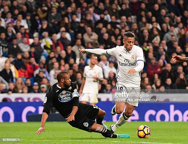 Real Madrid's forward Mariano Diaz vies with Deportivo La Coruna's Brazilian defender Sidnei during the Spanish league football match Real Madrid CF...